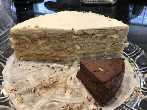 Malakoff torte made by Wilhelm Schlag (with smaller slice of flourless chocolate cake)